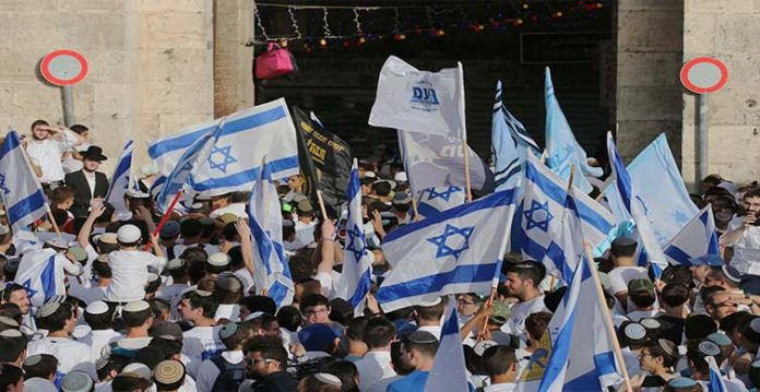 hamas warns israel not to renew tension over jerusalem flag march