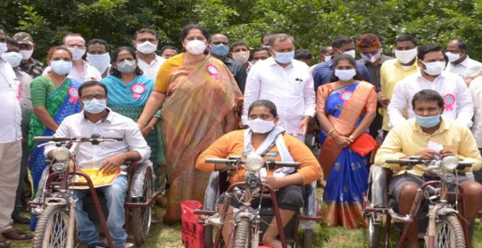 welfare continues in ts satyavathi gives tricycles to physically disabled
